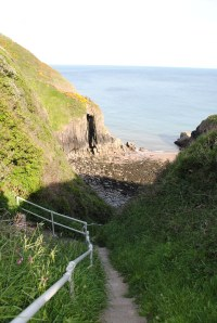 Looking down the steps to Churchdoors. You can see the rock formation that the bay got it's name from on the left.