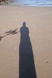 My shadow on the beach at Skrinkle Bay