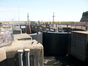 You can just see the masts of the boats waiting to come in above the massive gates of the locks
